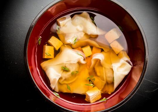 Clear soup with pumpkin dumplings