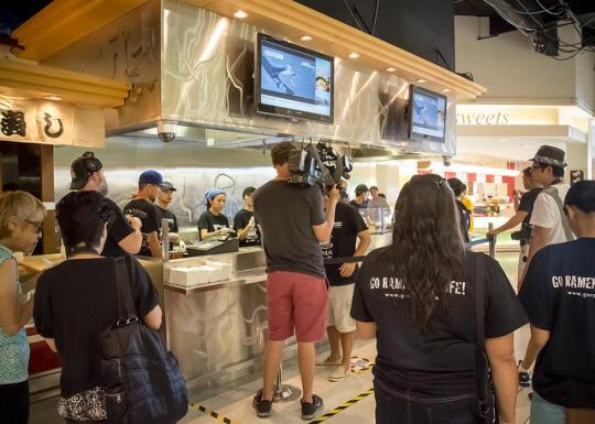 News stations filming ramen burger prep