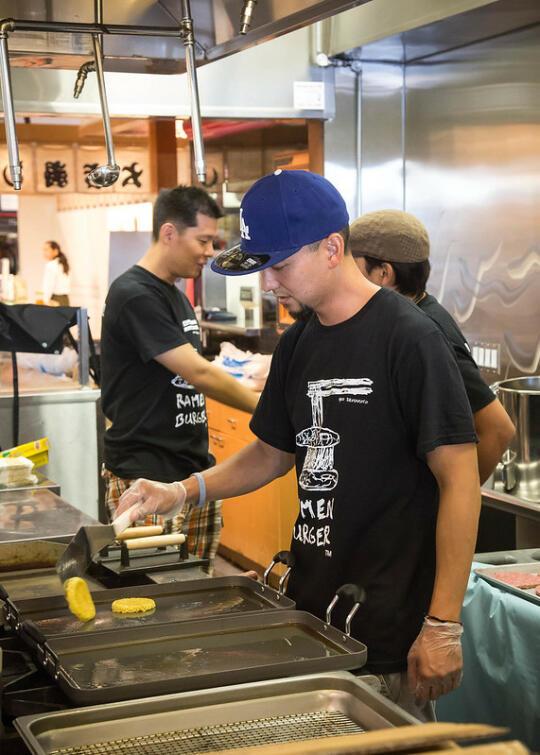 Chef Keizo flipping buns