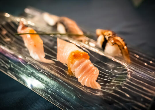Course 7: Suzuki (striped bass) nigiri with tobiko, seared albacore tuna belly nigiri, saba (mackerel) nigiri with candied kombu, black cod 'faux-nagi' (made to taste like unagi)