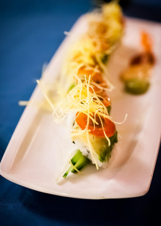 Course 8: Reggae Roll - vegan uramaki with asparagus and cucumber, topped with avocado, cherry tomato, and shaved pumpkin. Served with avocado puree, Sriracha aioli, and Sriracha sauce for dipping.