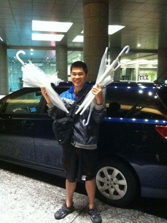 Son with all the Fujis' broken umbrellas