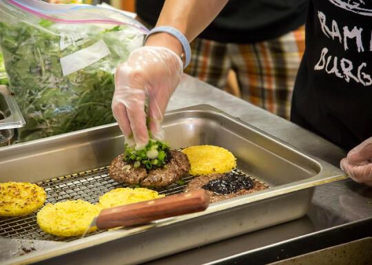 Chef Keizo showing how to prepare a ramen burger