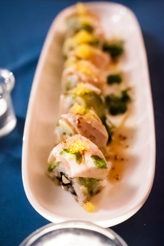 Course 8: Golden State Roll - uramaki filled with scallops, Sriracha, and green apple, and topped with avocado, albacore, masago, and an apple spice reduction. All ingredients are local.