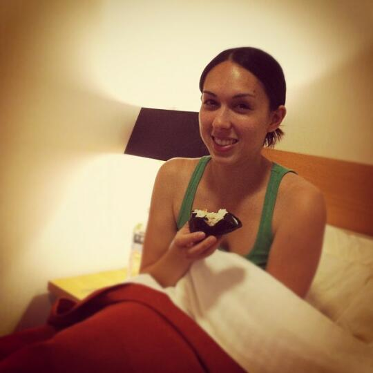 Allison in bed with an onigiri