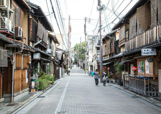 Smaller street lined with restaurants in the Gion area