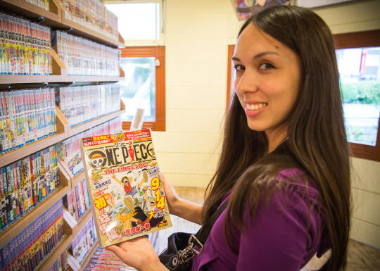 Allison holding the One Piece book we got