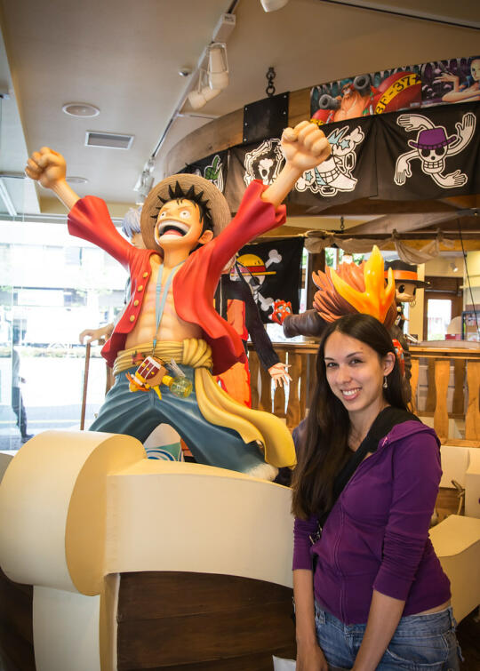 Allison standing with a Luffy statue