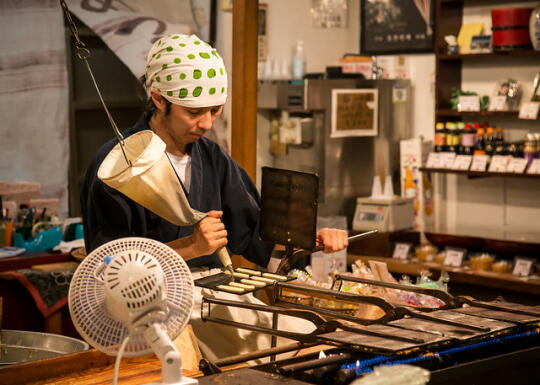 Man making senbei