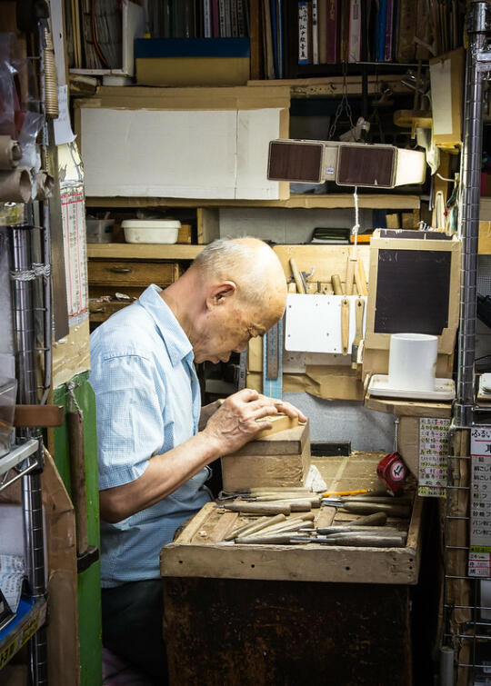A man carving wood