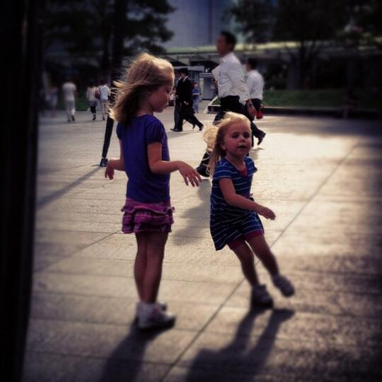 Rachael's girls running around beneath the spider statue