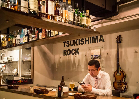 Businessman at the bar in Tsukishima Rock