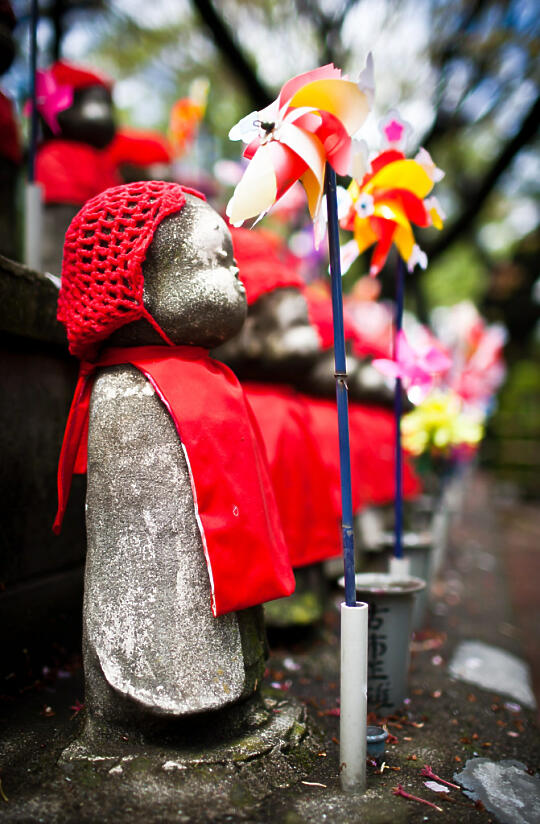 Dressed up children's statues with pinwheel