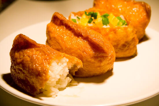 Inari-zushi, topped with tamago and green onion