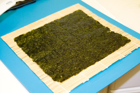 A piece of nori on the rolling mat