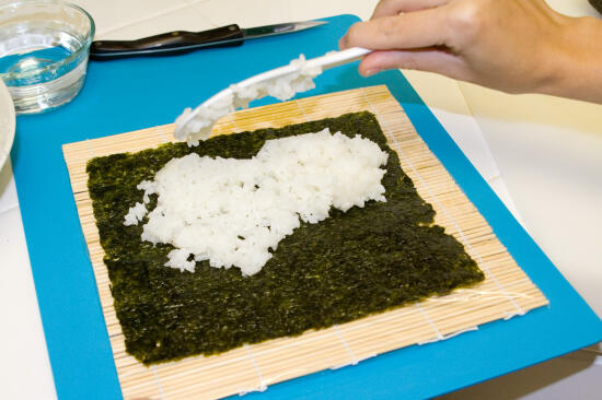 Placing the rice on the nori