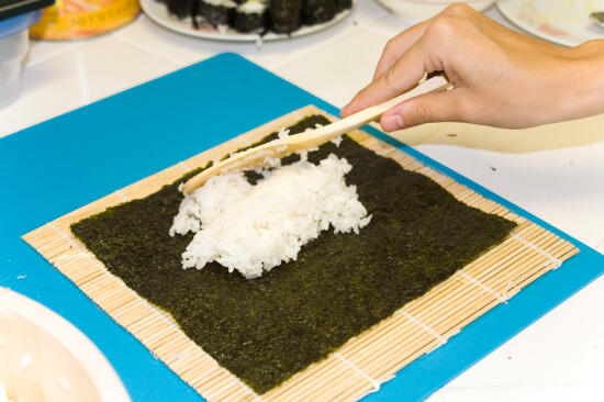 Placing rice on the nori