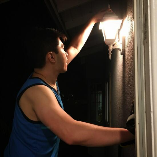 Son installing a light