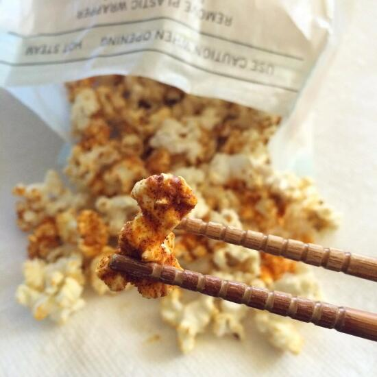 Eating popcorn with chopsticks