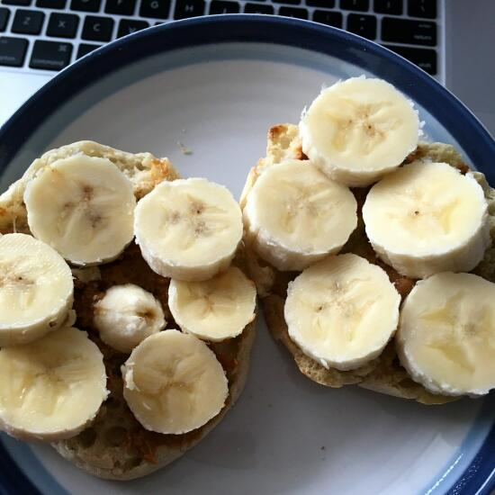 English muffin with peanut butter and bananas
