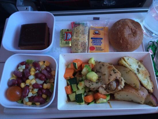 garlic chicken with potatoes, veggies, corn and bean salad, bread/butter, cheese/crackers, orange chocolate mousse