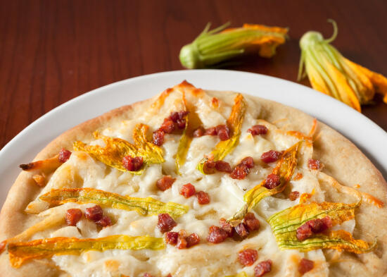 Zucchini blossom and pancetta pizza